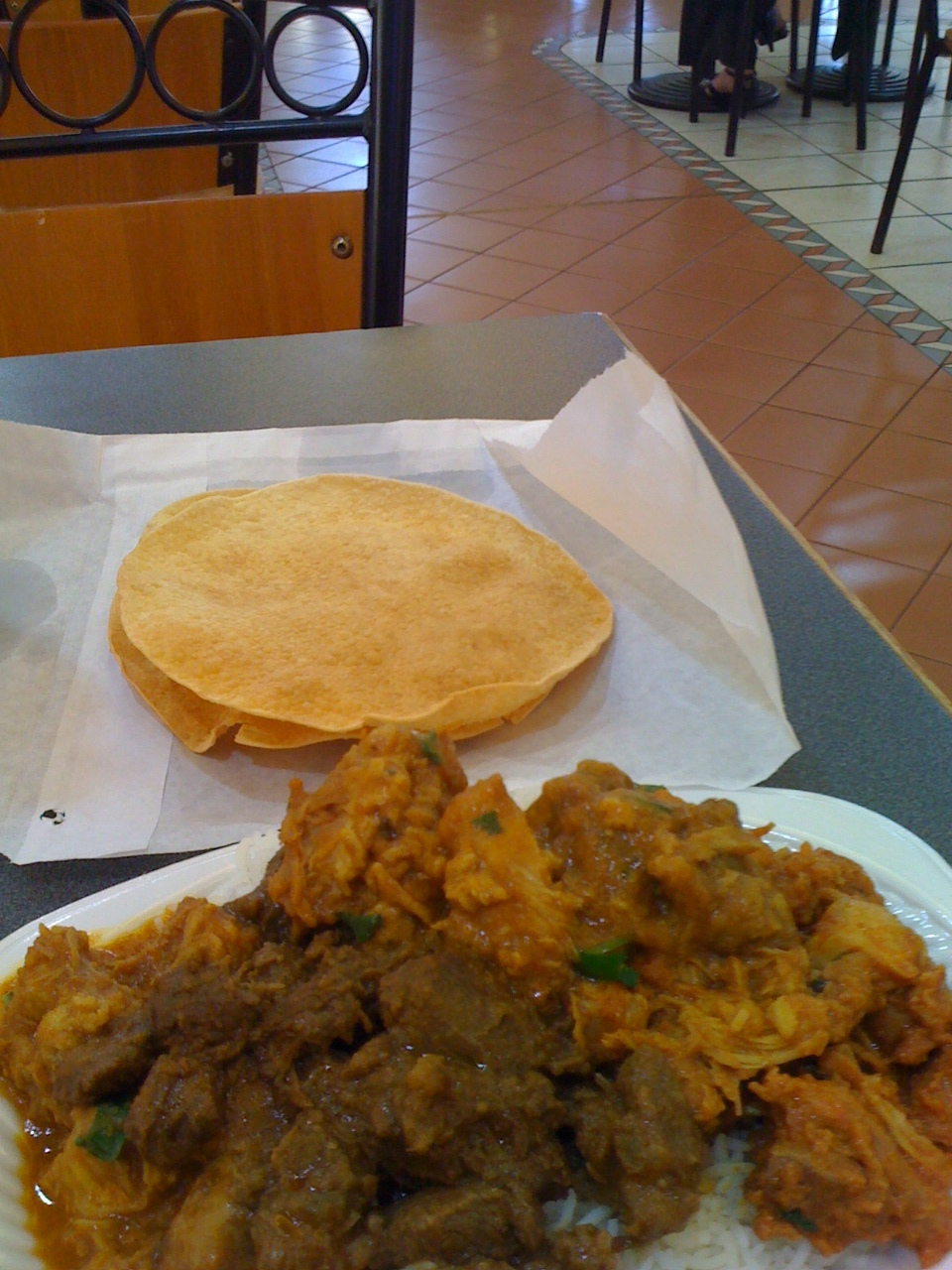 Medium sized dish with choice of three curries and chapatis at an Indian restaurant at the Cairns Night Market.