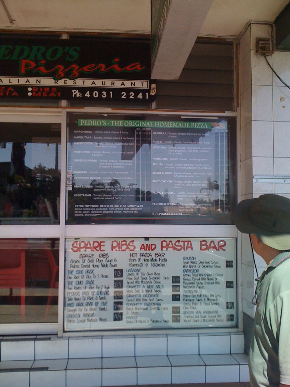 My Dad checks out the menu at Pedros Pizzera in North Cairns.