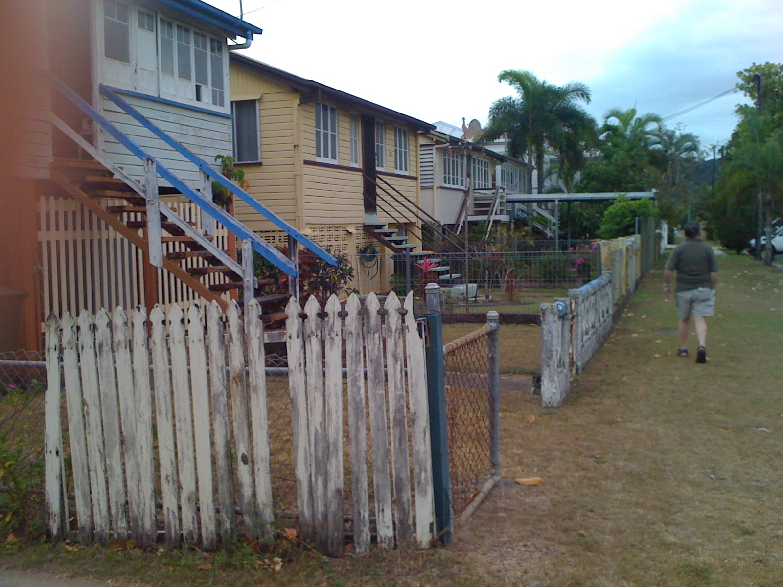 Rustic homes in the Queenslander style, raised off the ground to protect the occupants from floods, in the streets of North Cairns, in Australia.