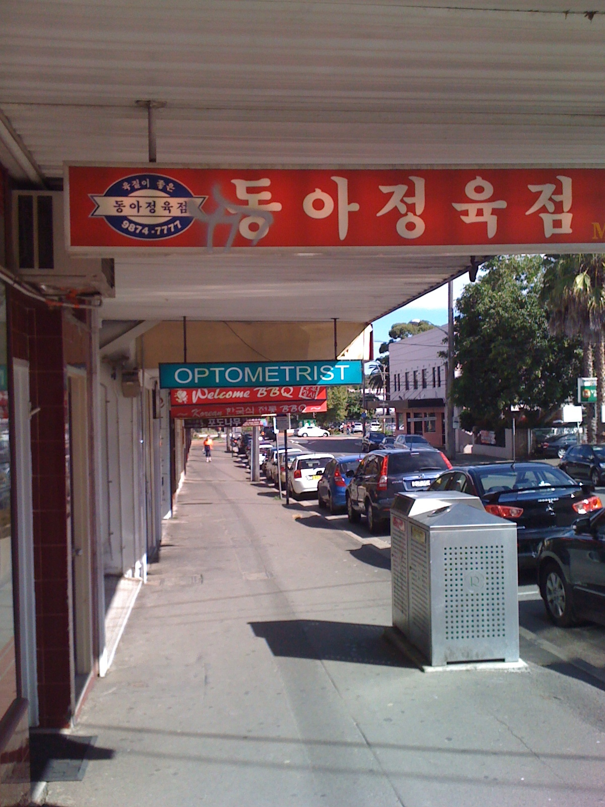 Korean hangul and Chinese signs line the mid morning streets of Eastwood, in Sydney's north-west.