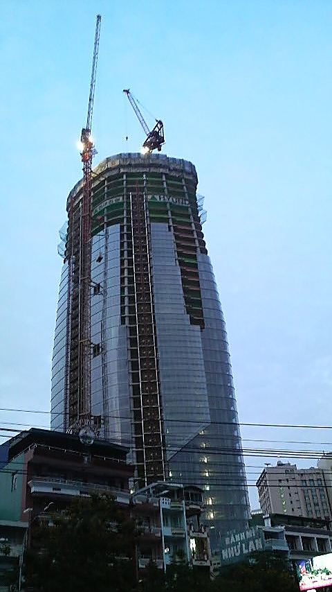 I could be wrong but this seems to be the Bitexco Financial Tower, under construction by Hyundai