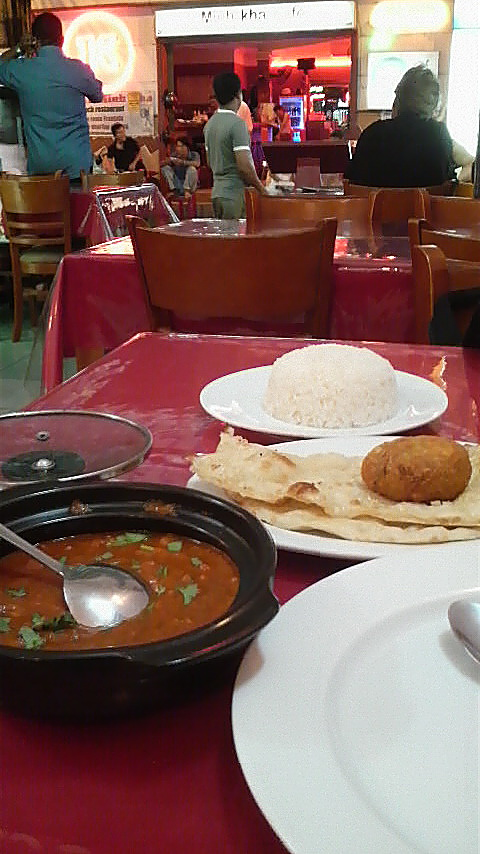 The 100,000 Dong set meal at Mughal: , accompanied by a flaky lacha paratha.