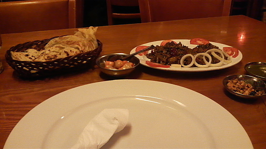 Mutton and pepper dish at Mumtaz, accompanied by a flaky lacha paratha.