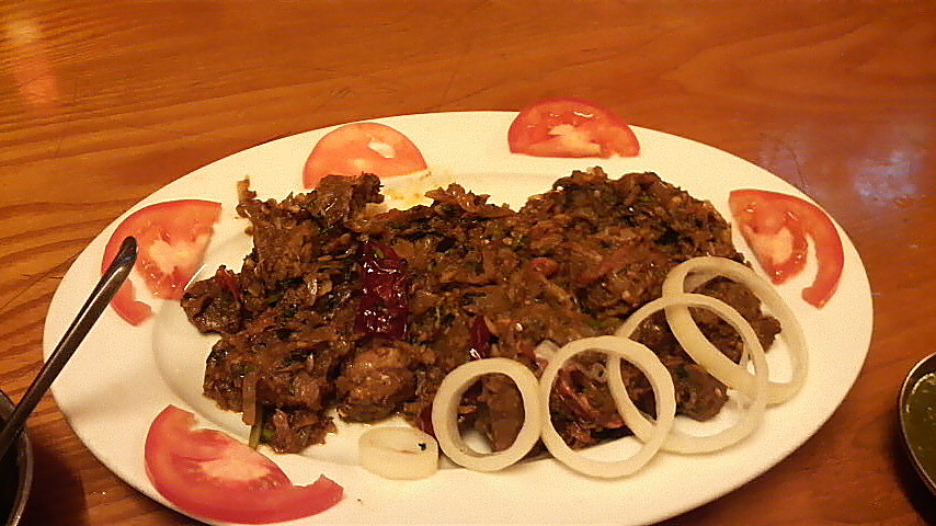 A close up view of that aforepictured pepper mutton dish, with garnishes.