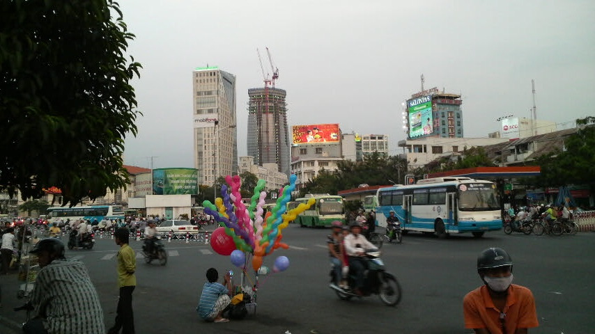 Street scene including balloon vendor near Ben Thanh Market