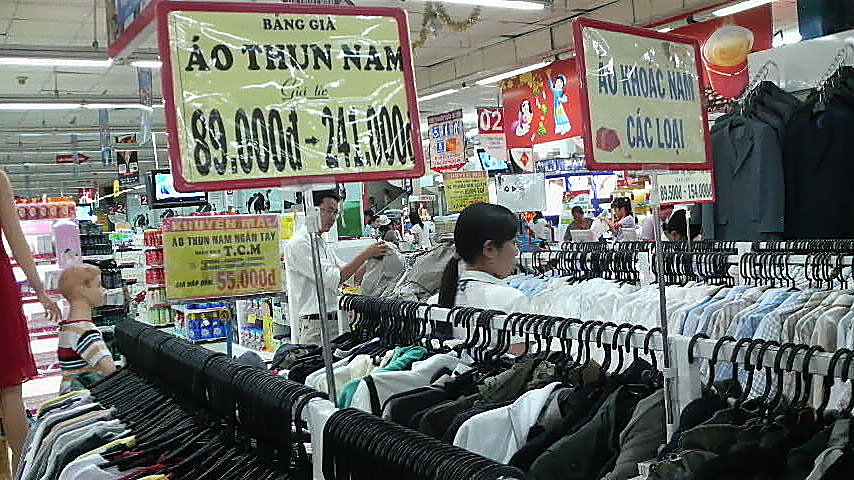 Clothes and in the background suits for sale in a Saigon supermarket